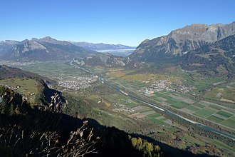 Alpine Rhine - The end of the Grisonian Rhine Valley where the Alpine Rhine turns around the Fläscher Berg to the north, east of Sargans. In front: Bad Ragaz on the left and Maienfeld on the right.