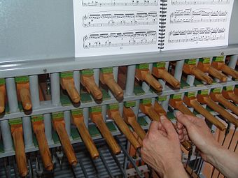 Carillonneur demonstrating using the sides of the hands to strike the clavier (keyboard). BIG 117025309040611.jpg