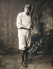 "Studio photograph of a man is in uniform, posing with a bat held as if about to strike. The picture is autographed ""Yours Truly, Babe Ruth""."