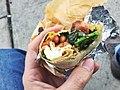 Bacon sausage burrito with fried egg, queso fresco, baby broccoli, pinto beans, chile morita.jpg