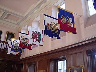 Officer of arms - Banners bearing heraldic badges of several officers of arms at the College of Arms in London.