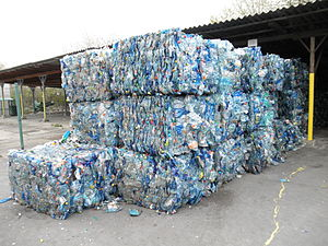 Polyethylene terephthalate - Bales of crushed blue PET bottles.