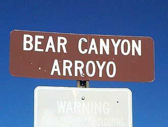 English in New Mexico - Spanish arroyo ('gulch', 'creek') is frequently used in the English of New Mexico, as on this sign for a paved Albuquerque drainage ditch that was once a natural ravine.