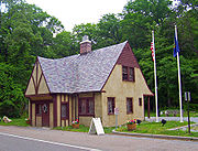 Old Bear Mountain Bridge Toll House along Routes 6 and 202 between bridge and Peekskill, today used as information center for surrounding parkland.