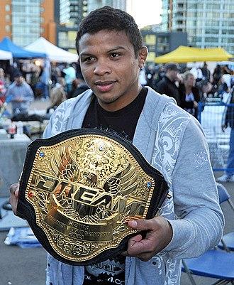 Bibiano Fernandes - Bibiano Fernandes hoisting his DREAM Featherweight Grand Prix championship belt.