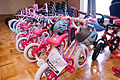 Bike giveaway caps Month of the Military Child 140502-A-DQ287-714.jpg