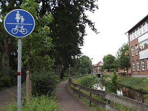 Cycling infrastructure - Signposted greenway, bordering on a gracht in Nordhorn, Germany