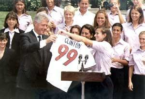 Timeline of women's sports in the United States - Image: Bill Clinton with 1999 USWNT