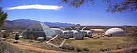 The grounds for Biosphere 2, including a large dome, temple, and several living spaces