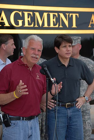 Rod Blagojevich - Quincy mayor John Spring appears at a press conference with Blagojevich to discuss Mississippi River flood-relief efforts in 2008.