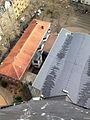 Blick von der Kirchturmspitze auf das Kirchendach, den Anna Saal und den Christine-Teusch-Platz.JPG