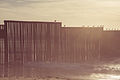 Border Fence Beach Sunset (15416796553).jpg