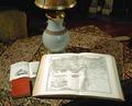 Bordet vardagssalongen, kartbok uppslagen. (Föremålsref. hänv. till mattan på bordet.) - Hallwylska museet - 30966.tif
