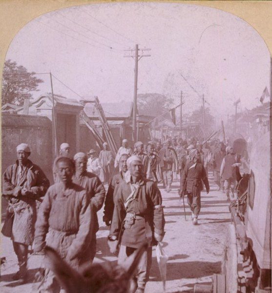 Group of Boxers walking down the street in Tien-Tsin,now called Tianjing