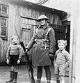 British Army soldier with local children, Torshavn, Faroe Islands.jpg