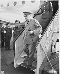 British Prime Minister Winston Churchill steps off his airplane at Gatow Airport in Berlin, Germany en route to the... - NARA - 198863.jpg