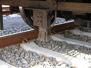 Crocodile (train protection system) - A corresponding train-mounted brush