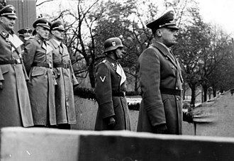 Friedrich-Wilhelm Krüger - During a parade of police forces (Cracow, 1939), Hans Frank (right), the Governor General of Poland, is standing in front of his deputies.  SS-Obergruppenführer Krüger, Höhere SS- und Polzeiführer for General Government (of Poland), is standing just behind Frank, wearing a steel helmet.
