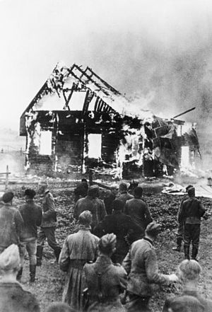 Wooden synagogues of the former Polish–Lithuanian Commonwealth - German soldiers observe burning wooden synagogue in Lithuania during World War II