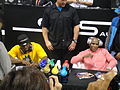 CES 2012 - SMS Audio - 50 Cent and boxer Floyd Mayweather sign for fans.jpg