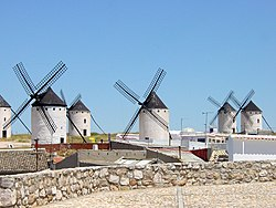 La Mancha's traditional windmills like these, still standing at Campo de Criptana, were immortalized in the novel Don Quixote.