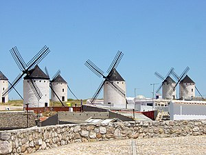 History of wind power - The vertical windmills of Campo de Criptana were immortalized in chapter VIII of Don Quixote.