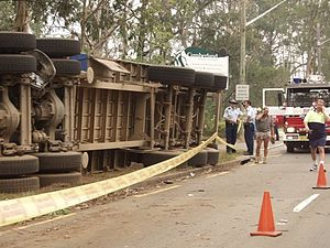 Road traffic control - Traffic cones placed around a rollover accident in Sydney.