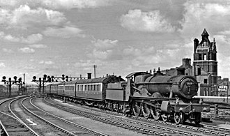 GWR 2900 Class - No. 2920 Saint David; from the third production series, built 1907, at Cardiff Central departing east towards Birmingham, 1953