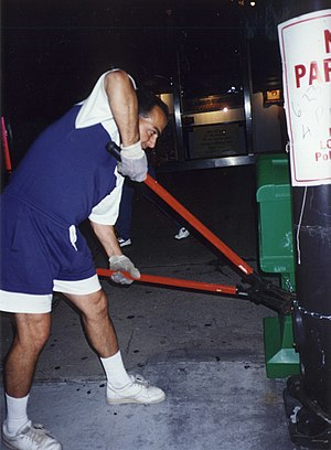 Chicago Jewish Star - An unidentified City of Chicago Streets and Sanitation worker illegally cuts the cable on a Chicago Jewish Star news box at the southwest corner of Michigan and Adams on the night of June 22, 1994. The City of Chicago had previously denied that any City worker had been authorized to move Jewish Star newsboxes.