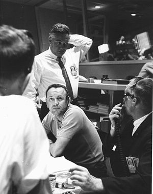 Christopher C. Kraft Jr. - Chris Kraft (seated) confers with Walt Williams and others during Mercury-Atlas 9.