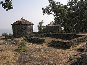 Citânia de Briteiros - Castro houses reconstructed by Martins Sarmento at the Citânia de Briteiros
