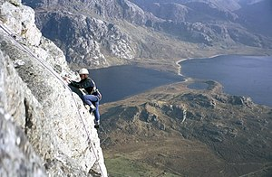 Climber on top pitch of Fionn Buttress. The Fi...