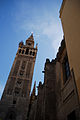 Close up view of the Giralda Seville ( bell tower for the Cathedral of Seville) as seen from Joaquín Romero Murube Str. Seville, Andalusia, Spain, Southwestern Europe.jpg