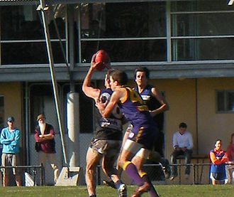 Melbourne University Football Club - A Melbourne University Blues player takes a mark in front of a Collegians opponent in a 2008 VAFA A Section Reserves match
