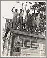 Colored boys playing on top of Coca Cola stand. Little Rock, Arkansas.jpg