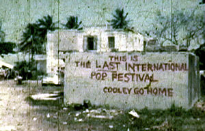 "Mar y Sol Pop Festival - ""COOLEY GO HOME"" A mural was painted near the festival's office by festival protesters."