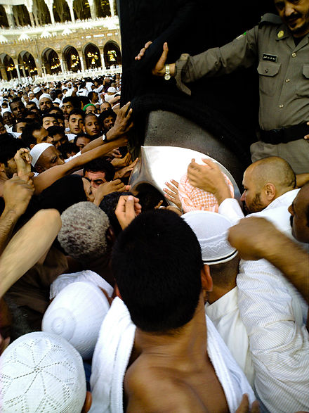 Muslim pilgrims jostle for a chance to kiss the Black Stone - Masjid al-Haram