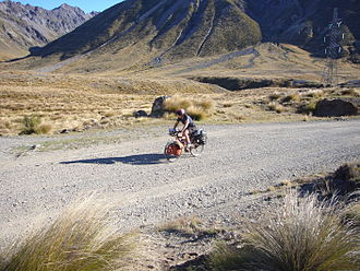 Cycling in New Zealand - A cycle tourist at Island Saddle between the Wairau Valley and Hanmer Springs in New Zealand.