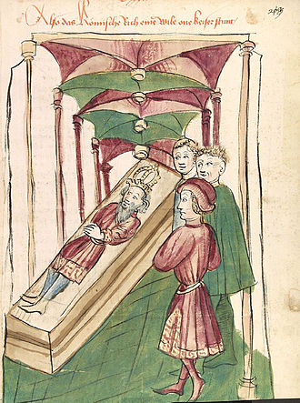 """Interregnum (Holy Roman Empire) - Depiction of the Interregnum in  Chronicon pontificum et imperatorum (c. 1450), showing three men standing at the tomb of an emperor with the caption """"Thus the Roman Empire for a time had no emperor""""  (Also das Römische rich eine Wile one keiser stunt)."""