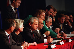 Dayton Agreement - Seated from left to right: Slobodan Milošević, Alija Izetbegović, Franjo Tuđman initialling the Dayton Peace Accords at the Wright-Patterson Air Force Base on 21 November 1995.