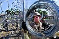 Defense.gov News Photo 110820-N-VV618-180 - U.S. Marine Corps Lance Cpl. Steven Cole unravels razor wire at the Esaie Jeanty Hospital Cite Soleil engineering site during Continuing Promise.jpg