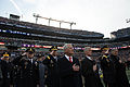 Defense Secretary Chuck Hagel, Army Secretary John McHugh, and other defense leaders listen to the national anthem before the 115th Army-Navy football game at M-T; Bank Stadium in Baltimore 141213-N-AF077-618a.jpg