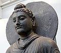 Detail, hornblende schist rock figure of Buddha, from Gandhara School, India, 200-300 CE. National Museum of Scotland, Edinburgh, Scotland, UK.jpg