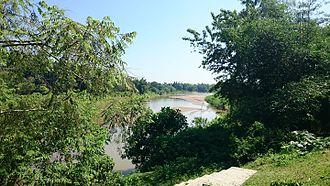 Dhalai River - Dhalai River behind trees