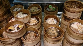 style of Chinese cuisine of bite-sized portions served in small steamer baskets or plates