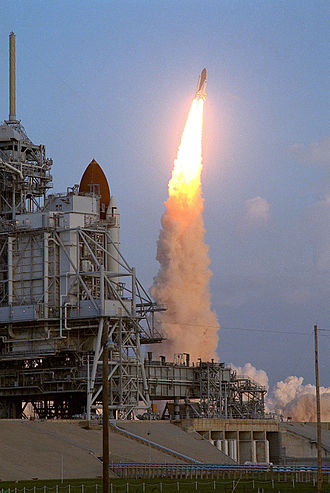 STS-41 - Discovery launches from Launch Complex 39B, with Columbia in view from its position on LC-39A.