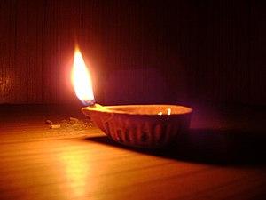 English: A lone diya (lamp) in the prayer room