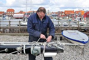 Dockworker in the harbour Ringkøbing, Jutland, Denmark.jpg