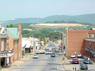 Waynesboro, Virginia - Downtown Waynesboro showing Main Street, as well as a scar on the mountain prior to being reseeded. The Wayne Theatre (under restoration) is visible at the extreme left of the photo.
