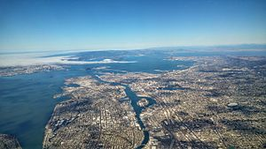East Bay (San Francisco Bay Area) - The East Bay in 2015, with the Bay Bridge connecting from Oakland to Treasure Island and San Francisco.